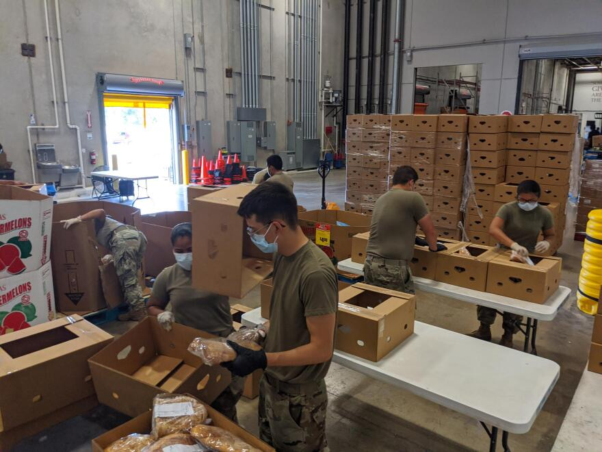 National Guard members pack baked goods. The guard work Monday through Friday at the San Antonio Food Bank.
