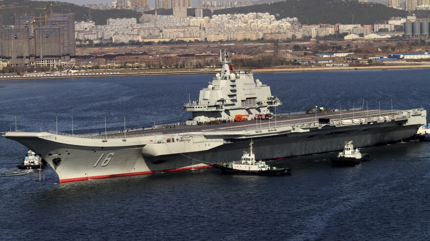 The Liaoning cruises back to port Oct. 30, 2012, after its first sea trial in Dalian, China.
