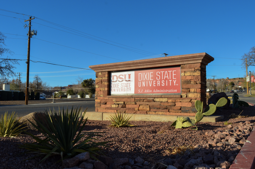 A photo of a sign which reads 'Dixie State University.'