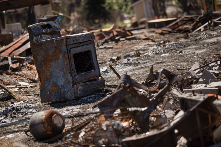 Debris from a burned home in Paradise waits to be cleared six months after the Camp Fire.