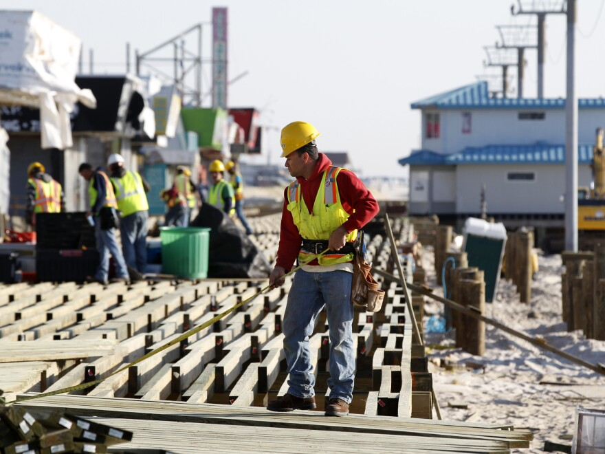 Construction workers work to rebuild the boardwalk in Seaside Heights in anticipation of Memorial Day weekend.
