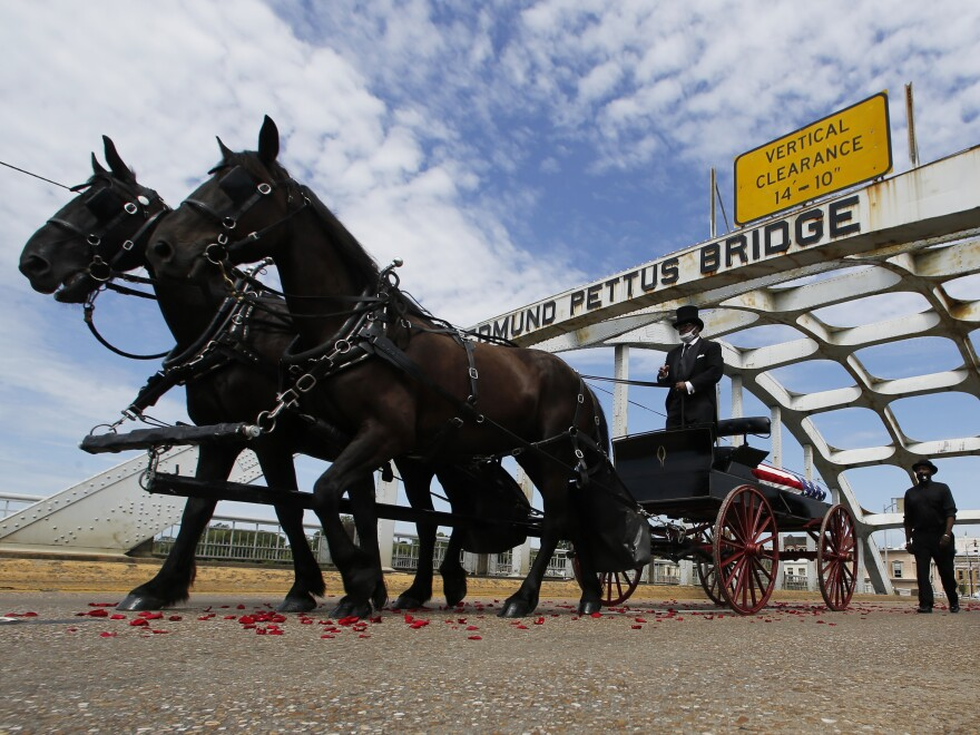 The casket of Rep. John Lewis crosses the Edmund Pettus Bridge by horse-drawn carriage during a memorial service for Lewis on July 26 in Selma, Ala.