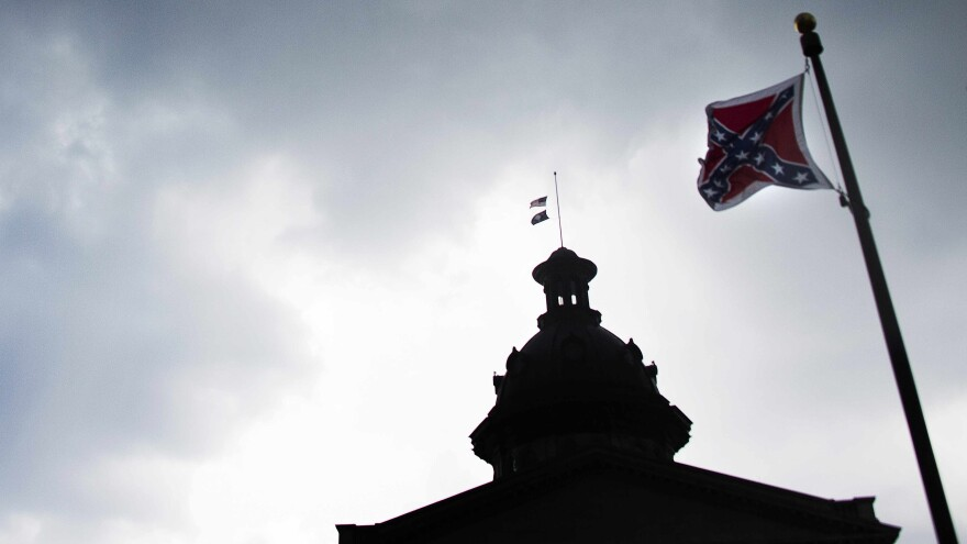 The Confederate battle flag flies at the South Carolina State House in Columbia late last month. The state's Senate voted Monday to remove the flag; after one more vote on the bill, it will head to the House.