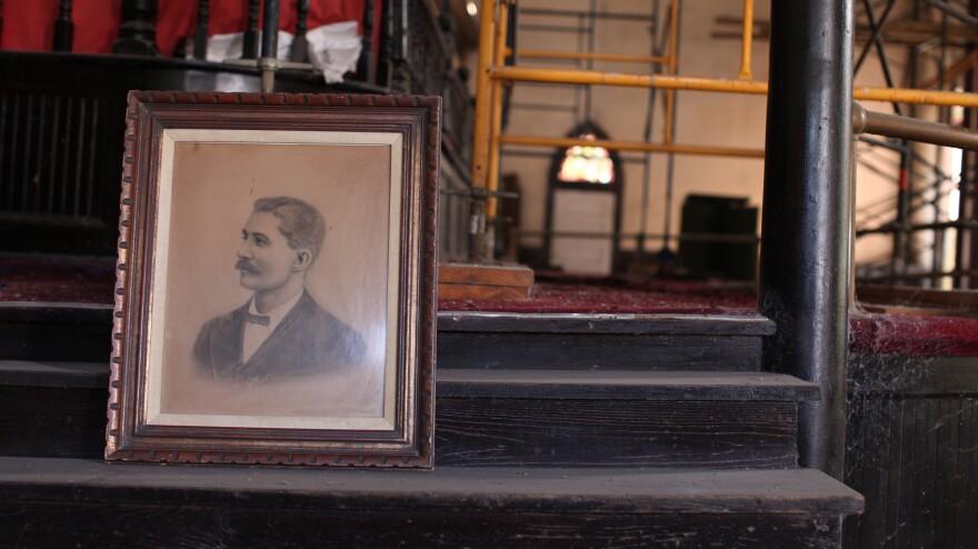 A portrait of Rev. Elias Camp Morris gathers dust inside the crumbling structure.