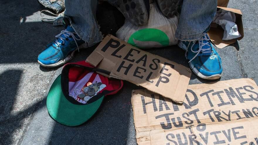 Andrew Loy begs along a sidewalk in San Francisco, Calif. on June 28, 2016.