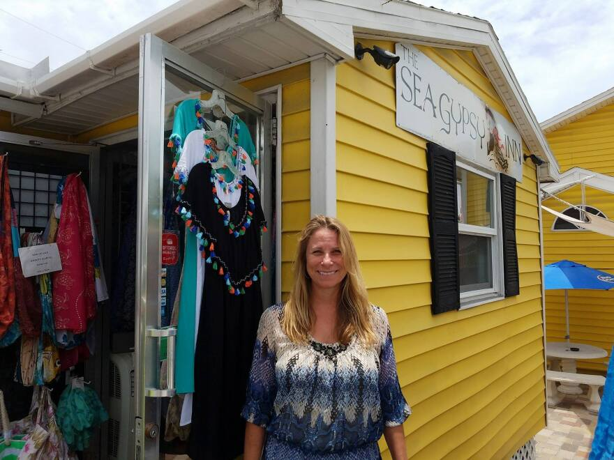 Jacki Liszak stands in front of the Sea Gypsy Inn