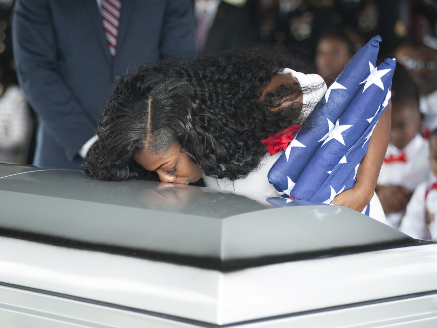 Myeshia Johnson kisses the casket of her husband, Army Sgt. La David Johnson, during his burial service on Saturday in Hollywood, Fla. Sgt. Johnson was killed in an ambush in Niger on Oct. 4.