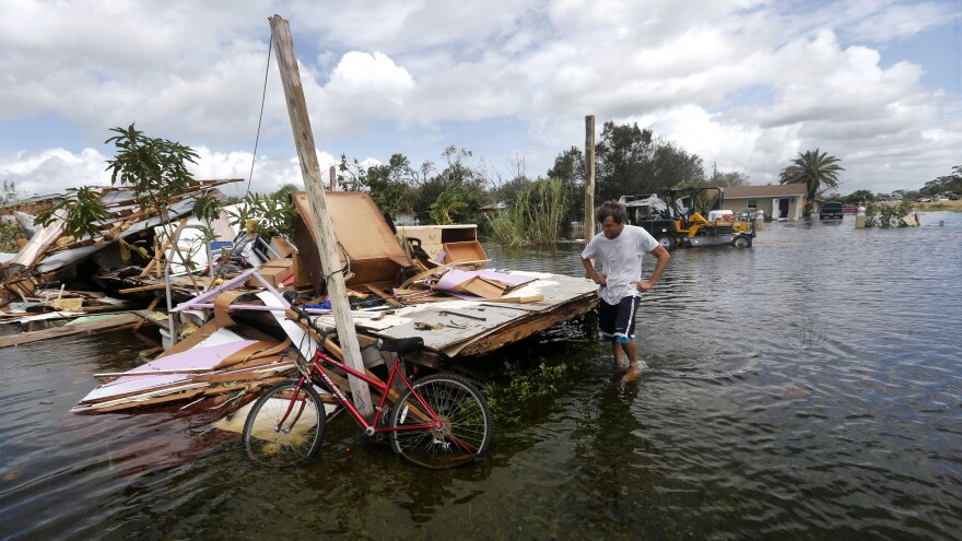 Larry Dimas walks around his destroyed trailer in the aftermath of Hurricane Irma in Immokalee, Fla., on Sept. 11, 2017. The World Meteorological Organization will no longer use Harvey, Irma, Maria and Nate to name hurricanes.