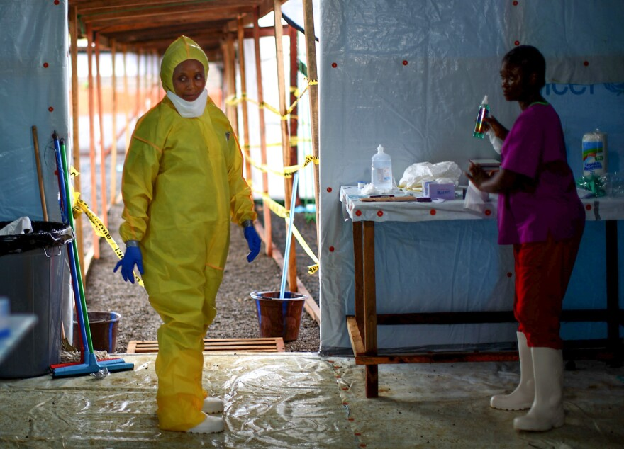 Some health workers in Liberia had stopped using the protective gear that was part of the Ebola routine. The photo above is from 2014, when the epidemic was at its peak.