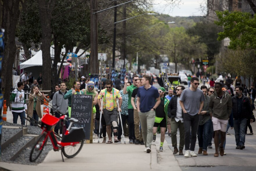 Crowds and scenes from Rainey Street in downtown Austin during South by Southwest Music Festival.