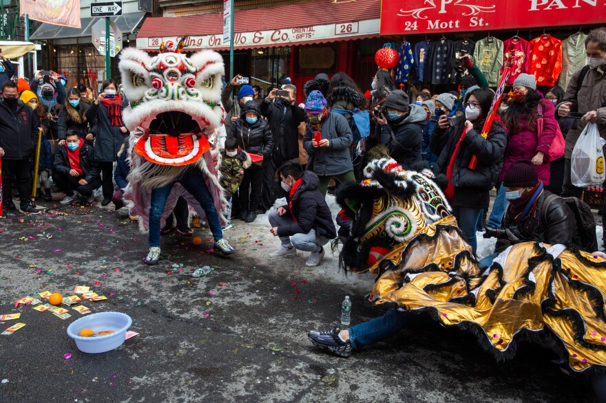 The Chinatown Community Young Lions perform lion dancing during the Lunar New Year festivities.