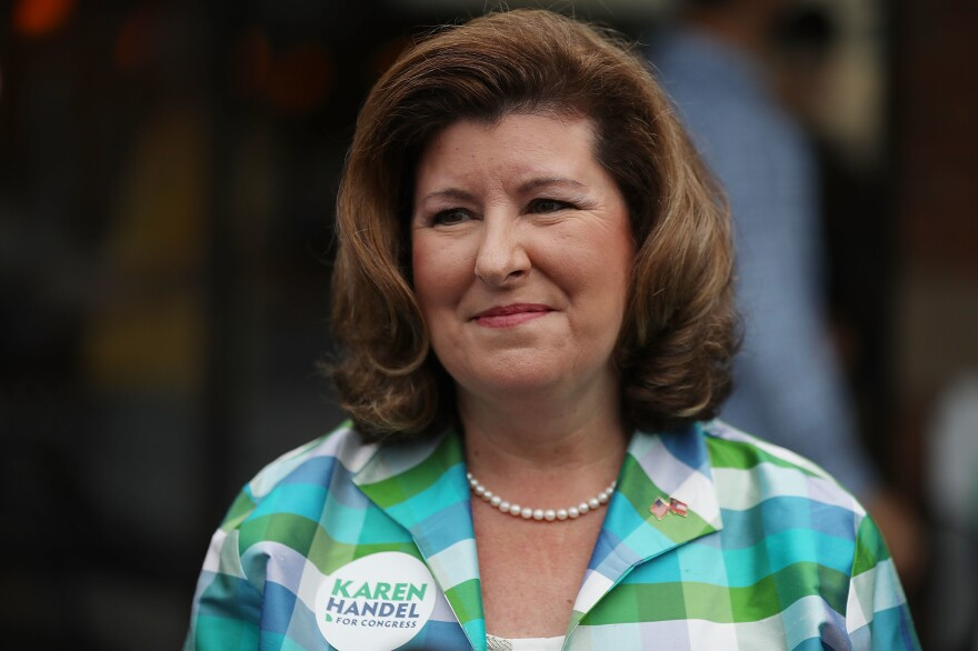 Republican candidate Karen Handel greets people during a campaign stop in her bid for Georgia's 6th District seat on Monday in Alpharetta.