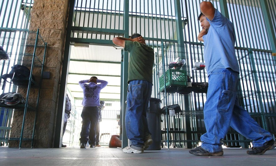 Immigrants suspected of being in the U.S. illegally are transferred to be processed at the Tucson sector of the U.S. Customs and Border Protection headquarters in Arizona in 2016.