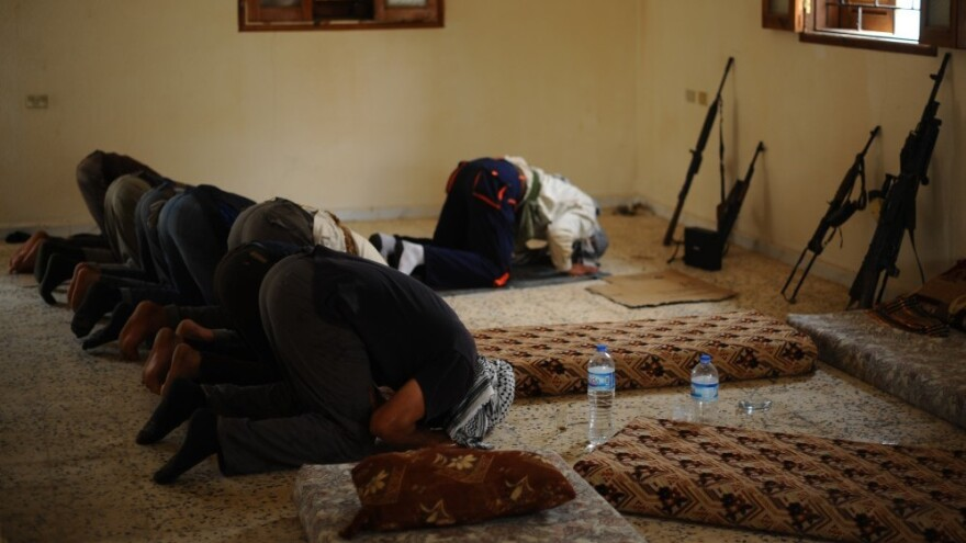 Libyan rebels pray before going out on patrol outside the port city of Misrata on April 30. Religion plays a major role in Libyan life, and Islamist groups want to be part of the new government.