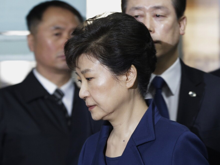Ousted South Korean President Park Geun-hye arrives at the Seoul Central District Court for a hearing in late March. Arrested shortly after that hearing, Park has now been formally indicted on corruption charges.