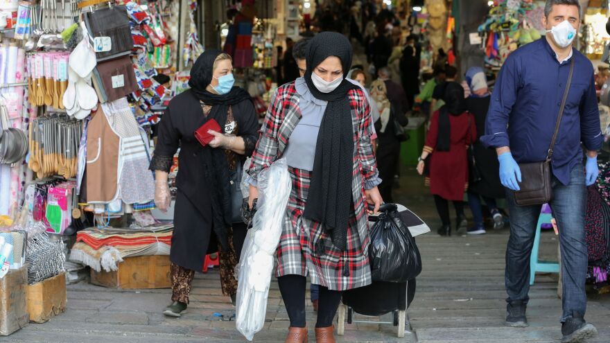 Iranians shop at the Grand Bazaar in Tehran on Monday. This week officials allowed major shopping areas to reopen, prompting a warning from Tehran's coronavirus task force.