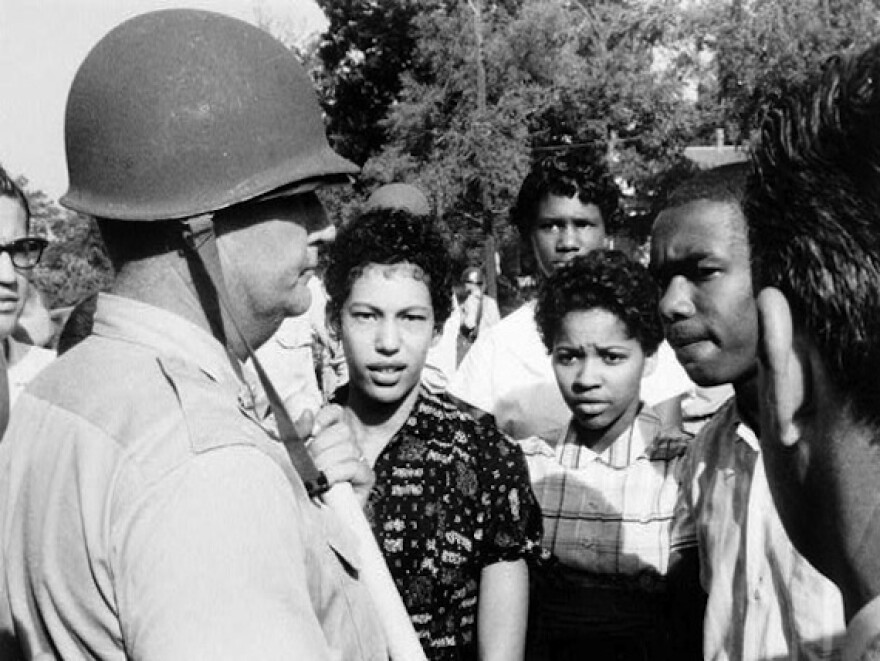 Arkansas law enforcement prohibits nine black students from entering Central High School in 1957.