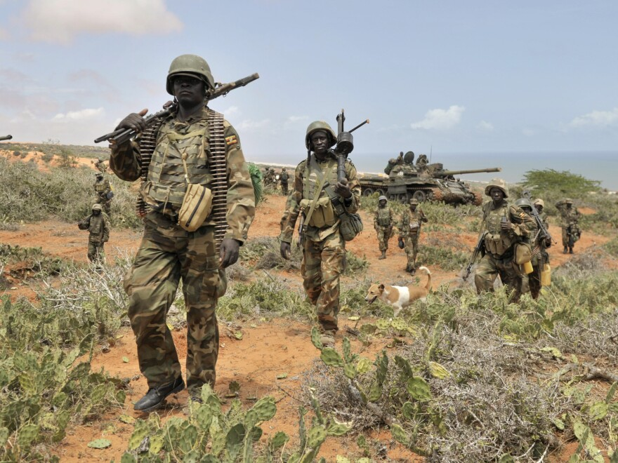 African Union Mission to Somalia (AMISOM), African Union soldiers march along the top of a hill overlooking the al-Shabab stronghold of Barawe, a coastal town 135 miles southwest of Mogadishu, in Somalia, in October.