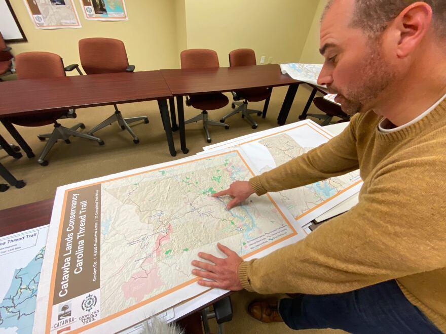 Project Director Bret Baronak shows a map of Catawba County's Carolina Thread Trail master plan