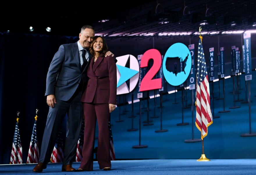 Vice President-elect Kamala Harris and her husband, Doug Emhoff, stand onstage during the Democratic National Convention on Aug. 19.
