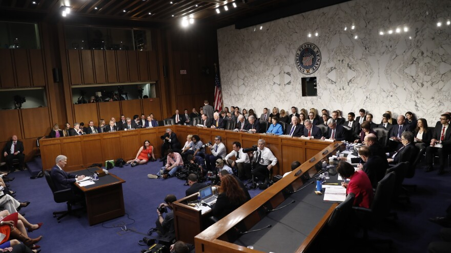 Supreme Court nominee Neil Gorsuch hears senators' opening statements on Monday for the first day of his confirmation hearings.