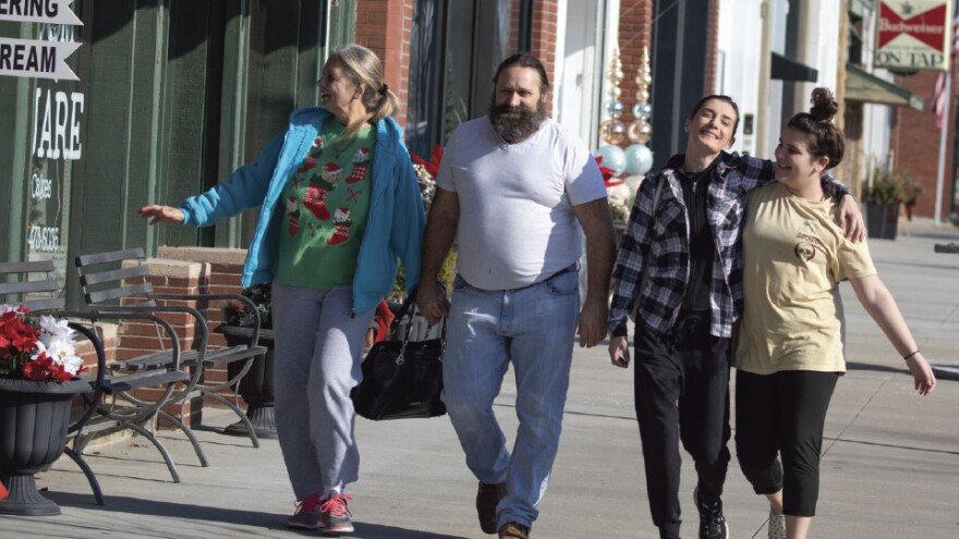 A shirt-sleeve day in early winter helped bring Cherolle Wright (from left), Larry Laid, Heidi Coykendall and Faith Coykendall to downtown Humboldt to do some Christmas shopping. (Photo by Jeff Tuttle, The Journal)