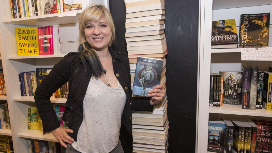 Lani Sarem poses with her novel <em>Handbook for Mortals</em> at the release party for the book in Chicago earlier this month.
