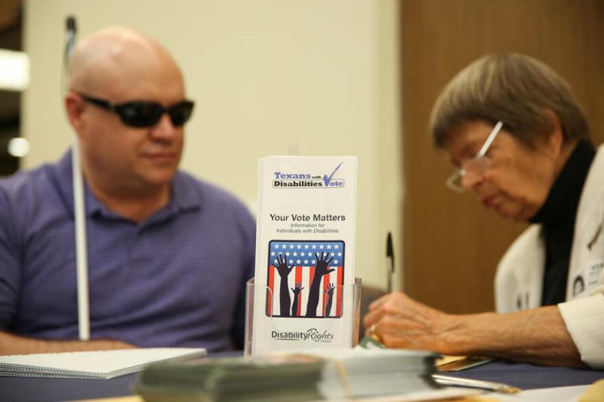 June Conway helps Eric Hood register