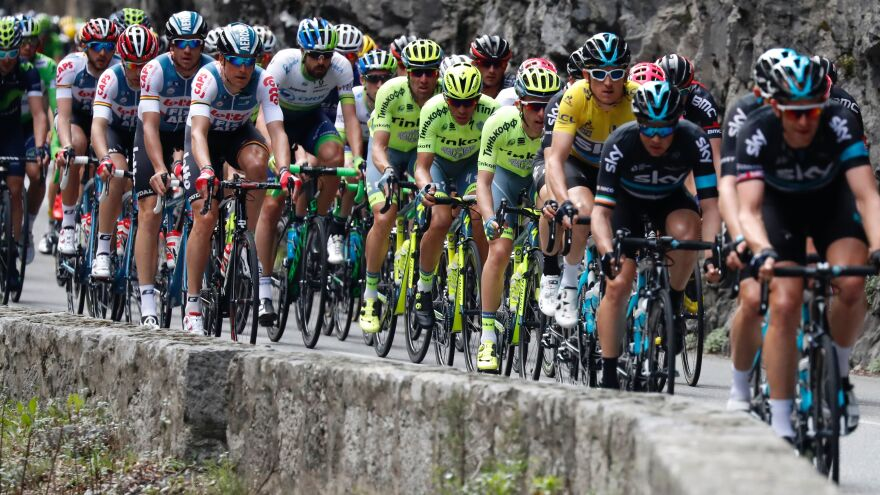 """Cyclists in this year's Tour de France will face new controls for what organizers call """"technological fraud."""" Here, elite cyclists are seen riding in the Paris-Nice race in March."""