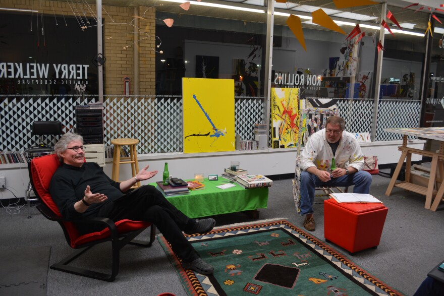 Terry Welker (left) and Ron Rollins (right) discussing art in their 3rd Space