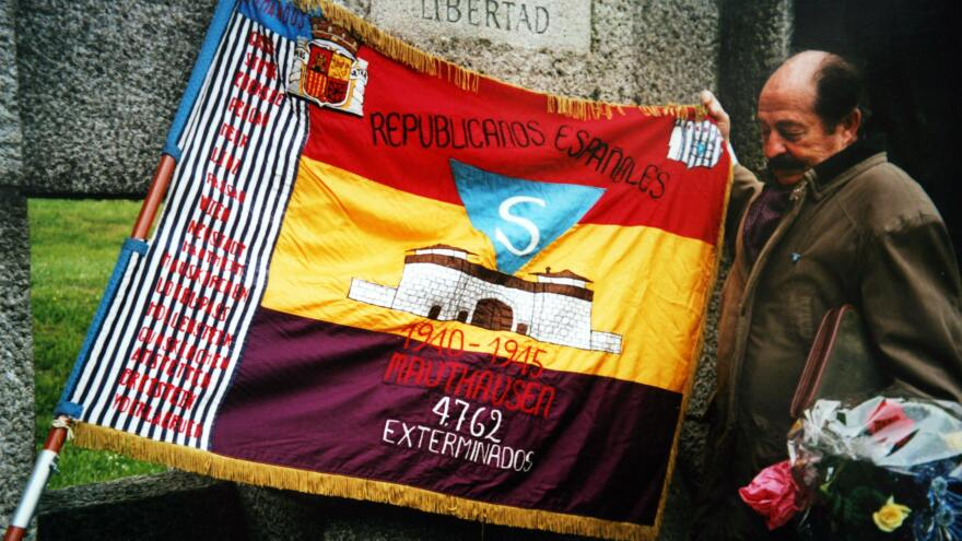 Enric Marco stands next to a Spanish Republican flag at Mauthausen camp in Austria in May 2003. Marco, who was chairman of an association of Spanish Republicans deported from France to Nazi concentration camps during World War II, admitted in May 2005 that his tale of surviving the Flossenbuerg camp was a lie.