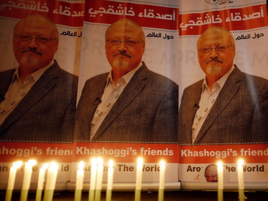 Candles burn in a memorial to slain journalist Jamal Khashoggi outside Saudi Arabia's Consulate in Istanbul in October 2018.