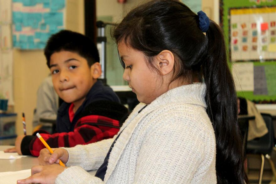 Second graders at Confluence Academy-South City draw graphs. The Confluence Academies, which are sponsored by MU, are the largest charter network in the state.