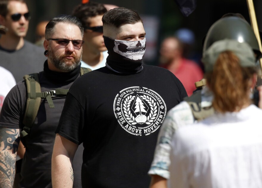 A white nationalist wearing a T-shirt with the Rise Above Movement logo attends the gun rights rally on Saturday. Rise Above Movement is a white supremacist group based in Southern California.