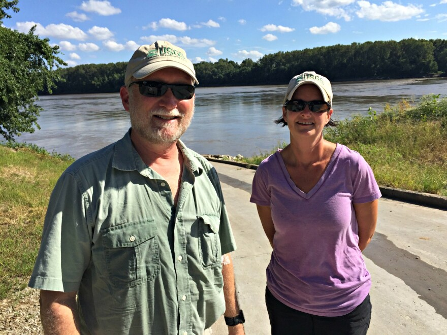 Hydrologist Robb Jacobson and geologist Carrie Elliott, both with the Geological Survey, monitor the water quality of the Missouri River.