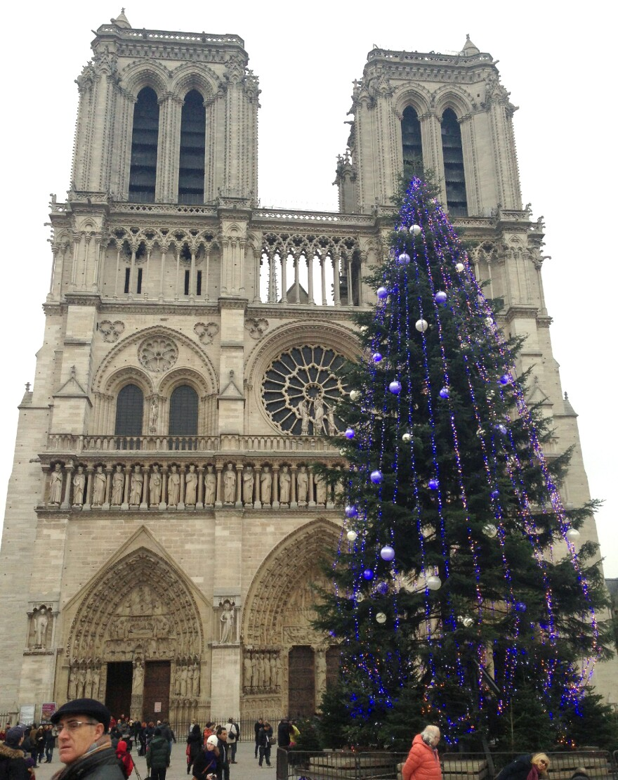 The Christmas tree outside of Paris' Notre Dame Cathedral is traditionally purchased by French groups and worshippers. This year it was a gift from the Russian government.