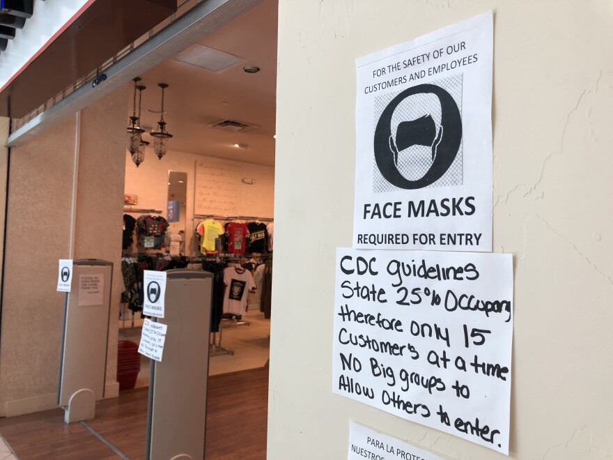 A sign outside a store in University Mall tells customers and employees face masks are required to enter. Pinellas and Pasco counties became the latest Tampa Bay area communities to require similar face coverings for businesses Tuesday.