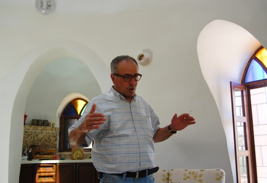 Ahmad Daoud's neighbors in Jericho are skeptical of his home, with its domed ceilings and walls packed with earth.
