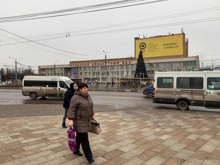 Pedestrians in Tula pass a concert hall. The gritty industrial town 100 miles south of Moscow has been a center of the Russian arms industry for 300 years.