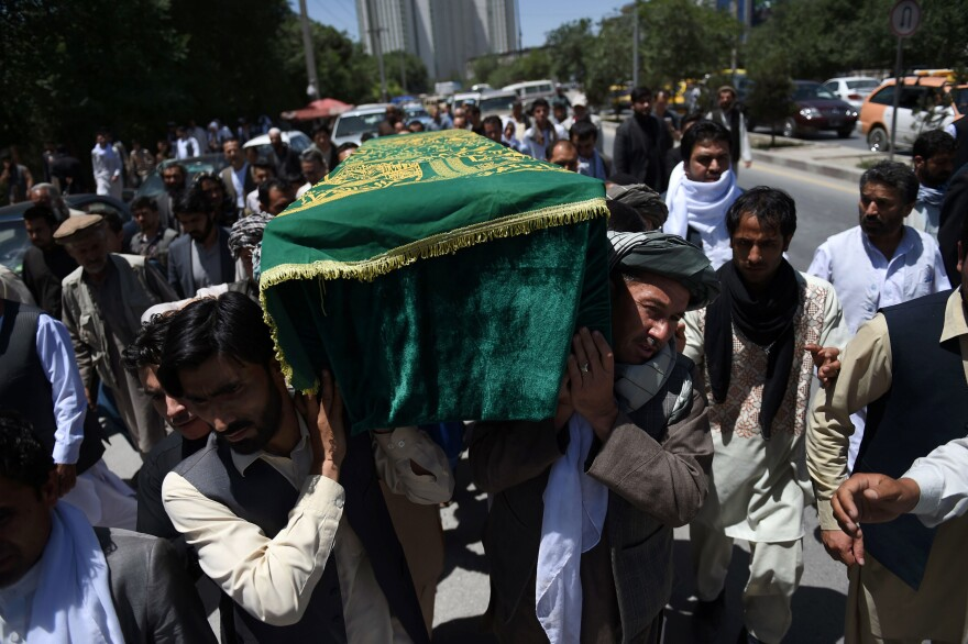 Relatives carry the coffin of Afghan journalist Zabihullah Tamanna ahead of funeral prayers Tuesday in Kabul. Tamanna, a 38-year-old father of three killed alongside NPR photographer David Gilkey in a Taliban ambush in southern Helmand province, is seen as one of the many unsung heroes of Afghanistan's media landscape who put their lives at risk to report on the conflict.