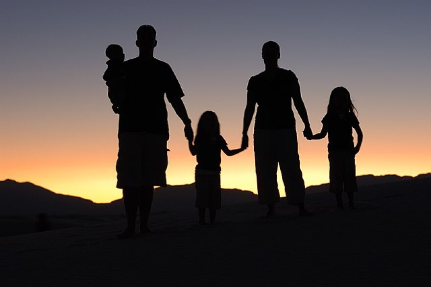 A silouette of a family
