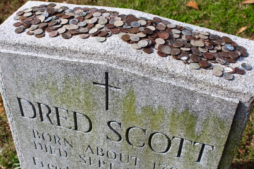 Visitors leave pennies on Dred Scott's tombstone at Calvary Cemetery in St. Louis. The pennies are believed to be a tribute to Scott and to President Abraham Lincoln who in 1863 issued the Emancipation Proclamation to free slaves.