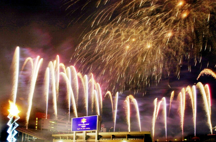 Fireworks fill the sky after the Olympic cauldron was lit on Feb. 8, 2003, marking the one year anniversary of the 2002 Winter Games at the opening and closing ceremony venue in Salt Lake City, the last American city to host the Olympics.