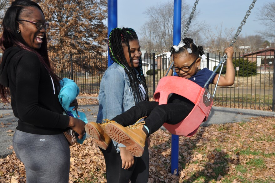 Jerlysha Boyd, 22, takes her daughter to the park on a Sunday afternoon. In the center is Coleman-Chambly's niece, Johnbene Chambly.