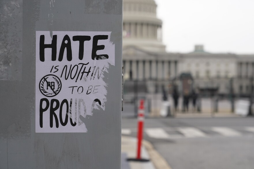 A protest sign is attached to a utility box near the Capitol Building in Washington, Friday, Jan. 8, 2021, in response to supporters of President Donald Trump who stormed the U.S. Capitol.