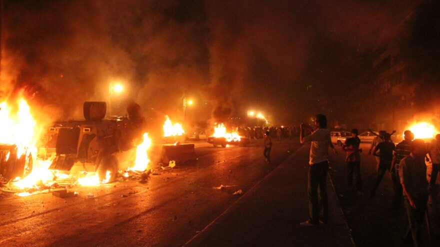 <p>Egyptian Coptic Christians clash with soldiers and anti-riot police during a protest in Cairo against the attack on a church in southern Egypt on Sunday.</p>