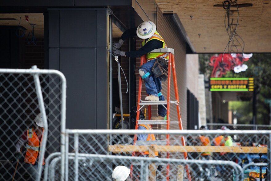 A construction worker at a building site at Trinity and Cesar Chavez in downtown Austin on March 23, 2020.