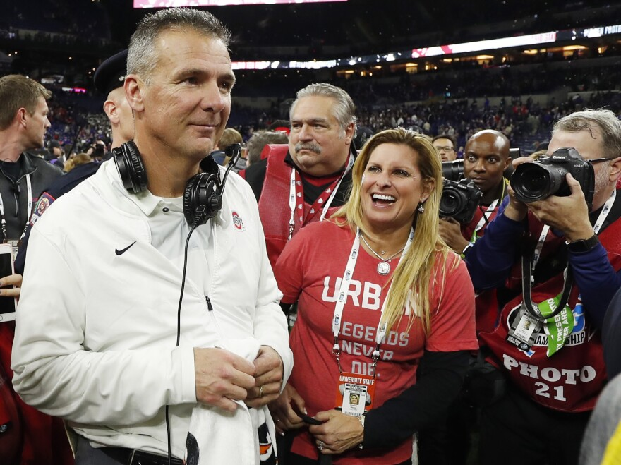 Ohio State Buckeyes coach Urban Meyer is retiring, the school said on Tuesday. He's shown with his wife, Shelley Meyer, after defeating the Northwestern Wildcats in the Big Ten conference championship game at Lucas Oil Stadium in Indianapolis.