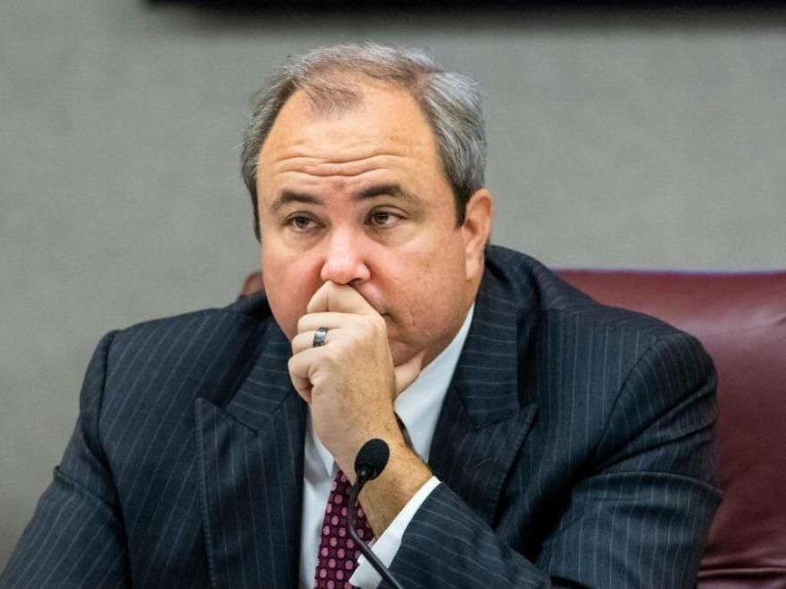 Joe Gruters listening during a meeting