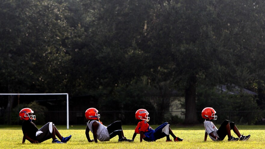 Members of the Jr. Peewee Gators do a drill during an early-season practice for Pop Warner football on Wednesday, August 7, 2013 in Gainesville, Fla.